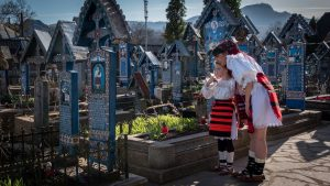 People dressed in traditional clothes at the Merry Cemeterry from Sapanta