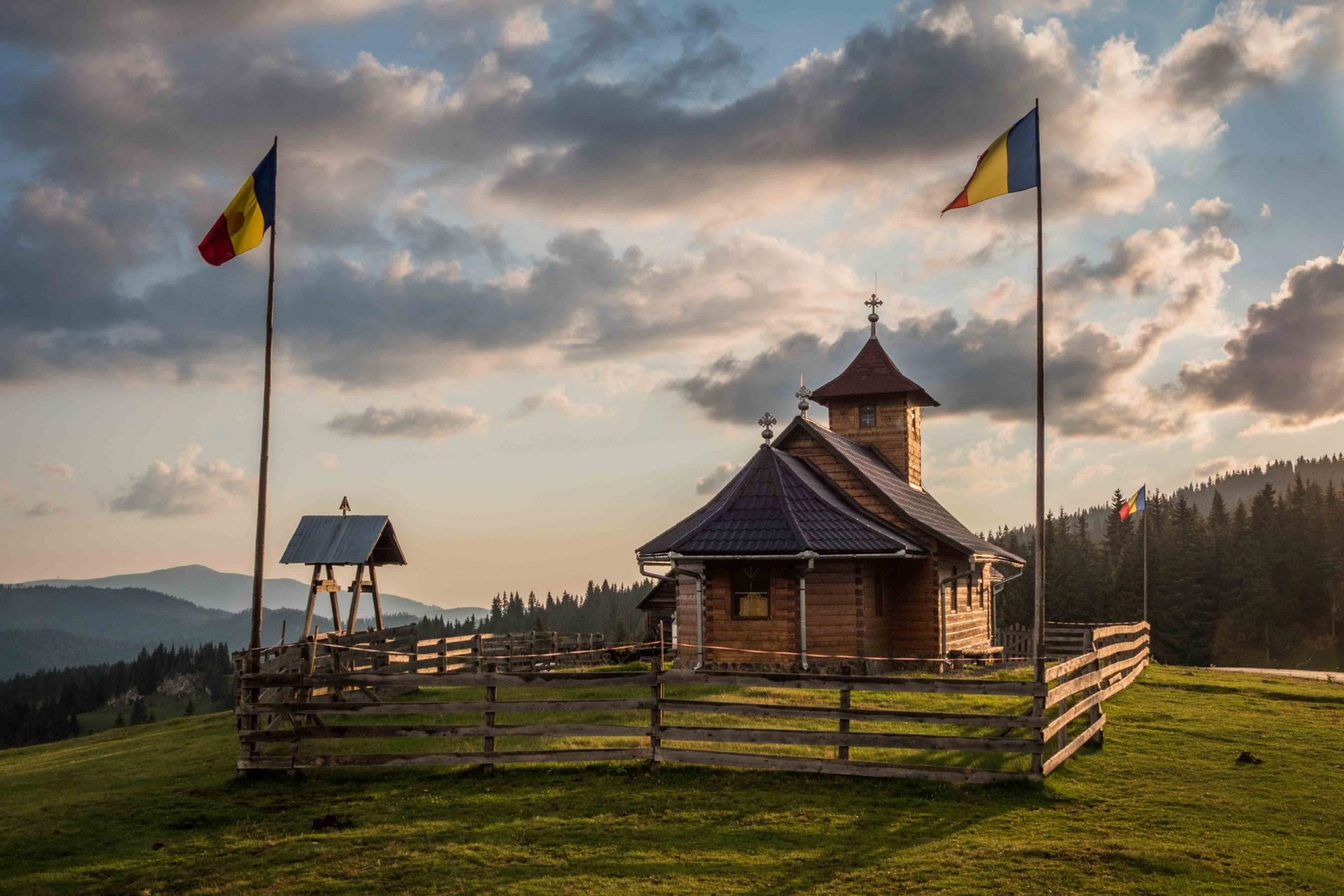 Wooden church and the Romanian flag