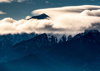 Snow-capped mountains peaks in the clouds