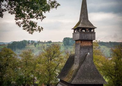 Wooden Church in Ieud shot from a nearby hill